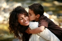 Little boy on mom back 13 Prairie Values for Raising Kids
